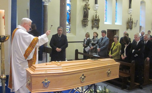 Fr McCabe blesses Fr Toms remains