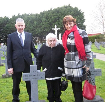 Ms Delia Bartley at grave of her uncle Fr Tom Bartley