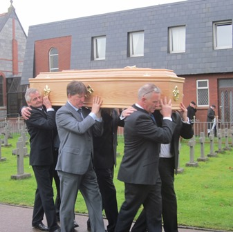 Nephews carry Fr Tom to cemetery