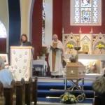 Mrs Paula Magee reads a prayer