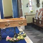 Coffin with Papal and State honours on cushion