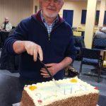 w.Fr Colum cuts birthday cake