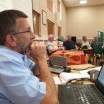 Br Michael Burke, CFC, listens intently